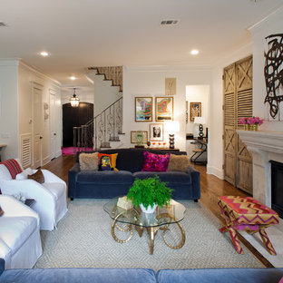 Example of a transitional open concept medium tone wood floor family room design in Houston with white walls, a standard fireplace and a stone fireplace