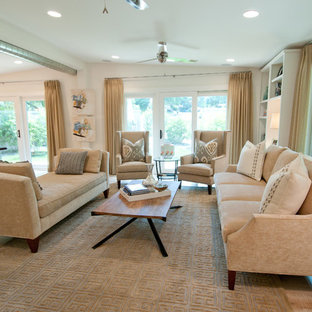 Example of a trendy open concept light wood floor family room design in Austin with beige walls