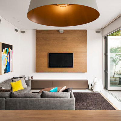 Example of a trendy open concept family room design in Perth with white walls, a wall-mounted tv and no fireplace