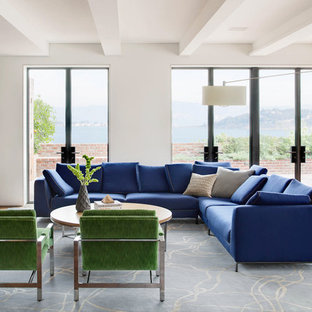 Family room - large contemporary open concept family room idea in San Francisco with white walls and a media wall