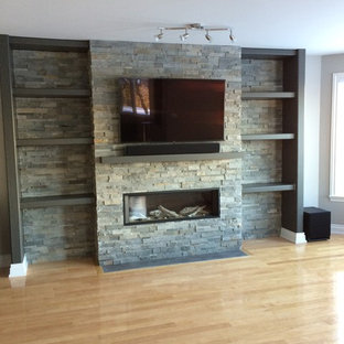 Television above Valor gas fireplace with stone cladding surround