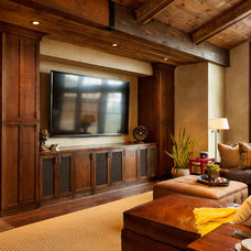 Contemporary Family Room by Master Woodworks inc