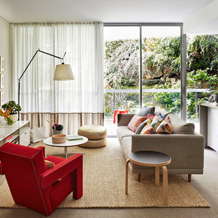 Family room - mid-sized contemporary open concept carpeted family room idea in Sydney with a wall-mounted tv and beige walls