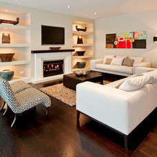 Tropical Family Room by Masonry Design Solutions Ltd