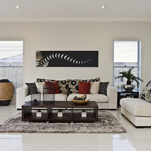 This is an example of a family room in Brisbane with grey walls and grey floor.