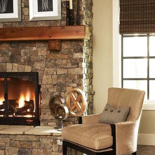 Idées déco pour une grande salle de séjour contemporaine ouverte avec un mur beige, un sol en brique, une cheminée standard et un manteau de cheminée en pierre.