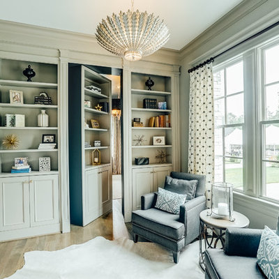 Inspiration for a timeless light wood floor family room library remodel in Richmond
