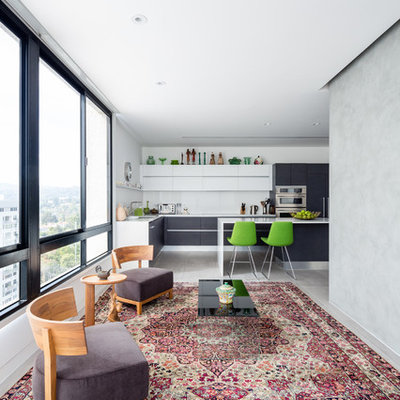 Example of a small trendy open concept carpeted family room design in Los Angeles with white walls and no tv