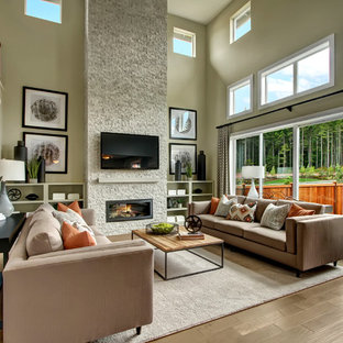 Inspiration for a craftsman open concept light wood floor family room remodel in Seattle with gray walls, a standard fireplace, a stone fireplace and a wall-mounted tv