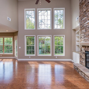 Example Of A Clic Open Concept Medium Tone Wood Floor Family Room Design In Other With