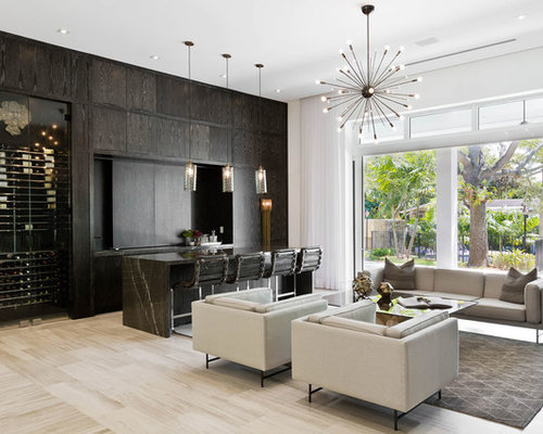 example of a trendy open concept family room design in miami with a home bar