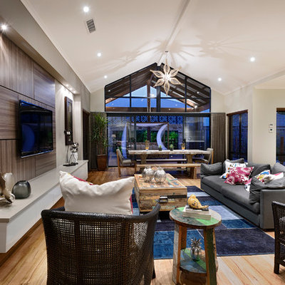 Inspiration for a large contemporary open concept medium tone wood floor family room remodel in Perth with beige walls, no fireplace and a wall-mounted tv