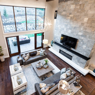 Mid-sized transitional open concept dark wood floor family room photo in Salt Lake City with gray walls, a standard fireplace, a stone fireplace and a wall-mounted tv