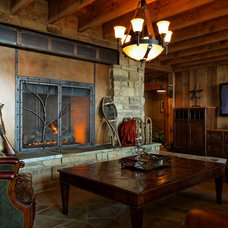 Rustic Family Room by Curt Hofer & Associates