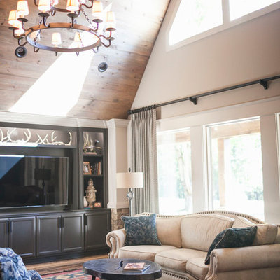 Family room - rustic enclosed dark wood floor and red floor family room idea in Other with white walls, no fireplace and a media wall
