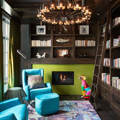 Inspiration for a large eclectic enclosed dark wood floor and brown floor family room library remodel in Calgary with a standard fireplace, a tile fireplace and gray walls
