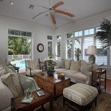 Tropical Family Room by Foresite Homes