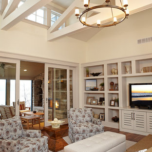Cottage open concept medium tone wood floor family room photo in Grand Rapids with beige walls and a media wall