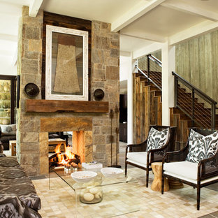 Family room - rustic family room idea in Atlanta with a stone fireplace