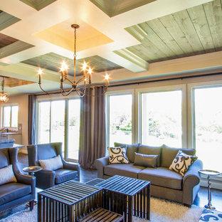 Exemple d'une salle de séjour chic de taille moyenne et ouverte avec un mur violet, un sol en bois foncé, une cheminée standard, un manteau de cheminée en pierre, aucun téléviseur et un sol marron.