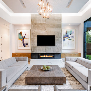 Family room - mid-sized contemporary light wood floor family room idea in Dallas with white walls, a ribbon fireplace and a wall-mounted tv