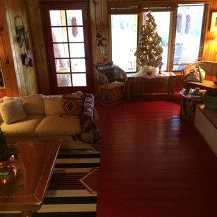 Large southwest open concept painted wood floor and red floor family room photo in Albuquerque with brown walls, a standard fireplace and no tv