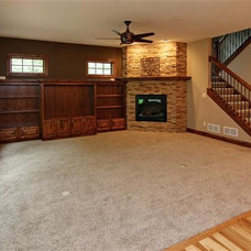 Traditional Family Room by F & B Construction Inc. Co MN Custom Home Builders