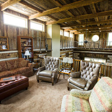 Rustic Family Room by Wilmes & Associates Architects