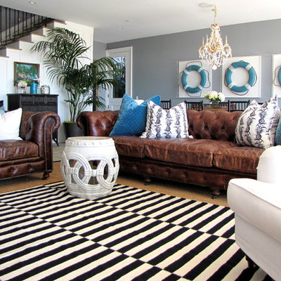 Elegant family room photo in Orange County with gray walls