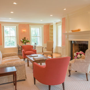 Example of a classic family room design in Burlington with pink walls