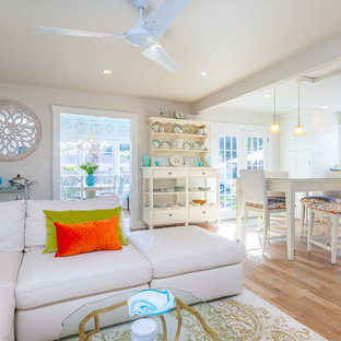 Small cottage chic open concept light wood floor family room photo in Tampa with gray walls and a wall-mounted tv