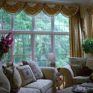 Family room - traditional family room idea in DC Metro with beige walls