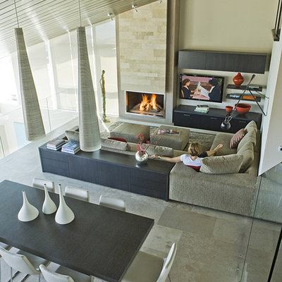 Example of a trendy open concept family room design in Los Angeles with beige walls