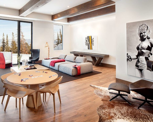 example of a trendy open concept light wood floor and brown floor game room design in - Family Room Design Ideas