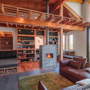 Inspiration for a rustic open concept family room remodel in Other with a stone fireplace and a wood stove