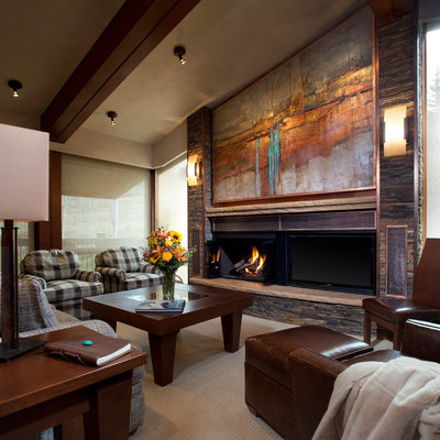 Family room - mid-sized contemporary enclosed carpeted family room idea in Denver with a standard fireplace, beige walls, a metal fireplace and a tv stand