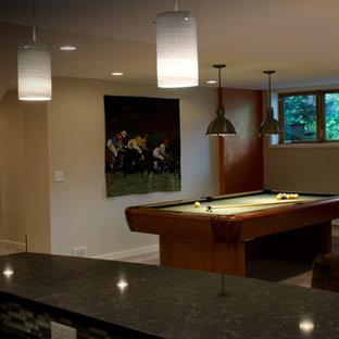ミネアポリスの大きいコンテンポラリースタイルのおしゃれなオープンリビング (ゲームルーム、標準型暖炉、レンガの暖炉まわり、埋込式メディアウォール) の写真