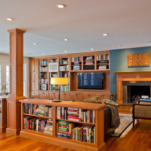 Example of a classic family room library design in Chicago with blue walls