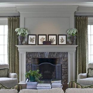 アトランタのトラディショナルスタイルのおしゃれなファミリールーム (ベージュの壁、標準型暖炉、石材の暖炉まわり、テレビなし) の写真