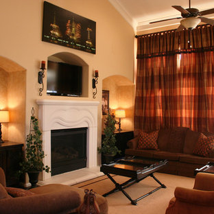 Inspiration for a timeless carpeted family room remodel in Houston with beige walls, a standard fireplace and a wall-mounted tv