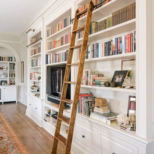 Example of a huge classic open concept medium tone wood floor family room library design in Other with gray walls, a standard fireplace, a tile fireplace and a tv stand
