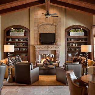 Elegant open concept family room photo in Phoenix with beige walls, a standard fireplace, a stone fireplace and a wall-mounted tv
