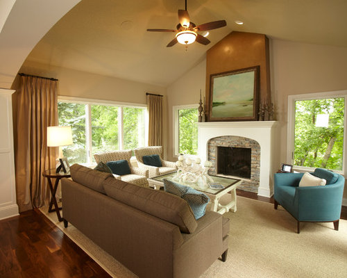 dual furniture. elegant family room photo in minneapolis with beige walls dual furniture