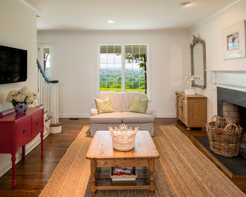fireplace slate. Example of a classic medium tone wood floor family room design in Baltimore  with beige walls Slate Fireplace Surround Houzz