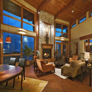デンバーのトラディショナルスタイルのおしゃれなファミリールーム (ベージュの壁、標準型暖炉、木材の暖炉まわり、テレビなし) の写真