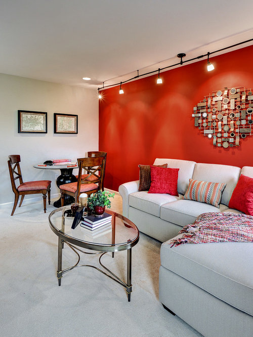 petite salle de s jour avec un mur rouge photos et id es d co de salles de s jour. Black Bedroom Furniture Sets. Home Design Ideas