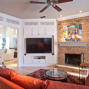 Family room - transitional family room idea in Dallas with a brick fireplace