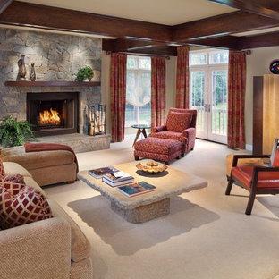 Ejemplo de sala de estar abierta, contemporánea, de tamaño medio, sin televisor, con marco de chimenea de piedra, paredes beige, moqueta, chimenea tradicional y suelo beige