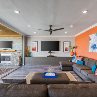 Family room - transitional open concept family room idea in San Diego with orange walls and a wall-mounted tv