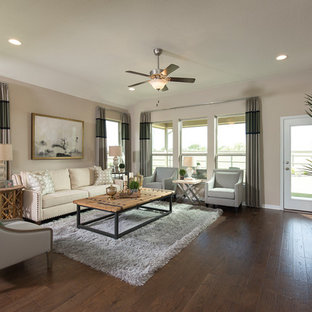 Transitional dark wood floor and brown floor family room photo in Other with beige walls and a wall-mounted tv